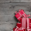 Pile of red Christmas gifts — Stock Photo #33597659