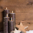 Burning candles, stars and snow  — Stock Photo