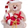 Teddy bear wearing Christmas hat — Stock Photo