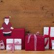 Christmas presents and gift boxes with Santa — Stock Photo