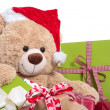 Teddy bear wearing Christmas hat — Stock Photo #33602661