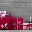 Red Christmas presents and gift boxes — Stock Photo #33603125