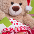 Teddy bear with gift boxes — Stock Photo
