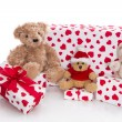 Teddy bears surrounded by gift boxes — Stock Photo #33604323