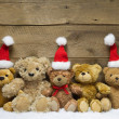Teddy bears with Christmas hats — Stock Photo