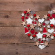 Christmas heart on a wooden background with different decoration — Stockfoto #33605951