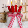 Christmas eve: four red burning candles — Stock Photo #33609153