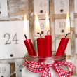 Christmas eve: four red burning candles — Stock Photo #33609571