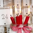 Christmas eve: four red burning candles — Stock Photo