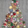 Christmas tree on a wooden background — Stock Photo