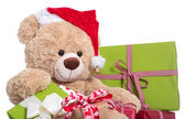 Teddy bear wearing Christmas hat — Stock Photo