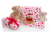 Teddy bears surrounded by gift boxes — Stock Photo