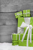Pile of green Christmas presents — Stockfoto
