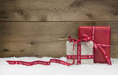 Red and white Christmas presents — Stock Photo