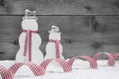 Christmas snowmen with ribbon — Stock Photo