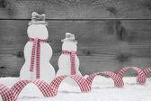 Christmas snowmen with ribbon — Stock Photo