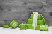 Green Christmas presents with snow — Zdjęcie stockowe