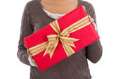 Woman holding Christmas present — Stock Photo
