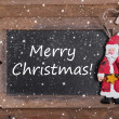 Chalkboard with Merry Christmas message — Stock Photo