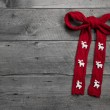 Red knitted bow with deers — Stock Photo #33610705