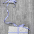 Giftboxes with blue striped ribbon — Stock Photo #33625381