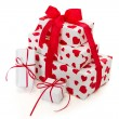 Giftboxes wrapped in heart patterned paper — Stock Photo