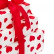 Giftboxes wrapped in heart patterned paper — Stock Photo #33625877