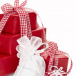 Presents wrapped in red and white paper — Stock Photo
