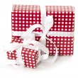Stock Photo: Presents wrapped in checkered red paper