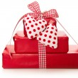 Stock Photo: Presents wrapped in paper with hearts