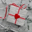 Gift box wrapped in paper — Stock Photo