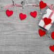 Gift box wrapped in paper with hearts — Stock Photo