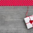 Gift box wrapped in paper with heart — Stok fotoğraf