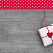 Gift box wrapped in paper with heart — Stock Photo