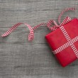 Present wrapped in red paper — Stock Photo