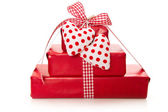 Presents wrapped in paper with hearts — Stock Photo