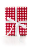 Gift box wrapped in checkered paper — Stock Photo