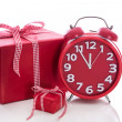 Big gift box with red alarm clock  — Zdjęcie stockowe