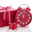Big gift box with red alarm clock — Stock Photo #33691829