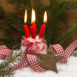 Christmas card decorated with burning candles — Stock Photo