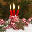 Christmas card decorated with burning candles — Stockfoto