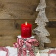 Christmas wooden tree, stars, candle and snow — Stock Photo