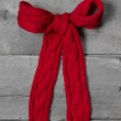 Red knitted bow for present — Stock Photo
