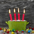 Four red christmas candles — Stok fotoğraf
