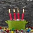 Four red christmas candles — Stockfoto