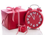 Big gift box with red alarm clock — Стоковое фото
