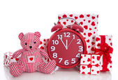 Presents with clock and teddy bear — Stock Photo