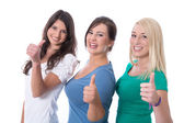 Group of happy trainees girls in first jobs with thumbs up isola — Stock Photo