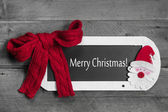 Christmas greeting card in red — Stock Photo