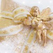 Stock Photo: Golden present box with angel playing violin